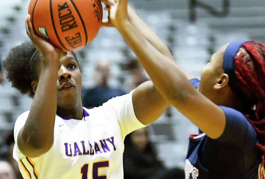 UAlbany's forward Jessica Fequiere (15) puts up a shot against St. John's during the second half of an NCAA college basketball game on Thursday, Nov. 30, 2017, in Albany, N.Y. St. John won the game71-66.(Hans Pennink / Special to the Times Union) ORG XMIT: HP113 Photo: Hans Pennink / 20042275A