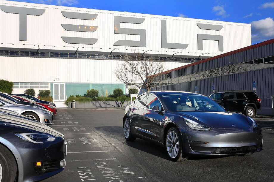 A Tesla Model 3 is seen in Fremont. Tesla built 9,766 Model 3 sedans during the first three months of 2018, quadrupling the number made in the final quarter of 2017. Photo: Lea Suzuki / The Chronicle