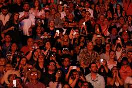 Fans cheer as Garth Brooks enters the stadium to perform after Round 1 of Super Series I of the Houston Livestock Show and Rodeo Tuesday, Feb. 27, 2018 in Houston.