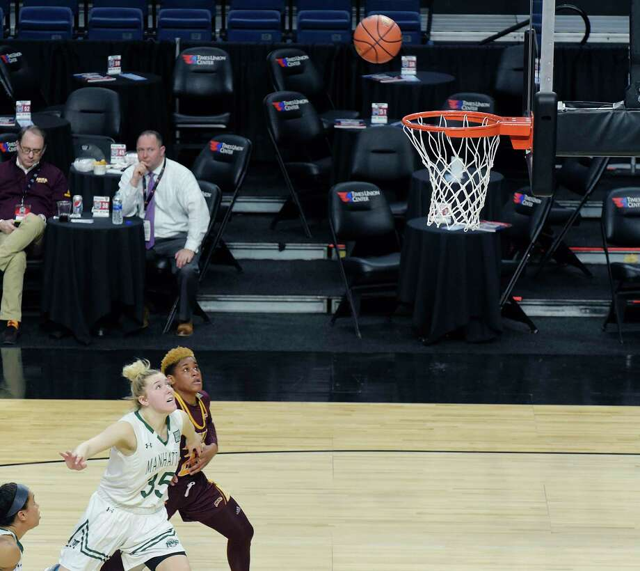 Kayla Grimme of Manhattan, left, and Alexis Lewis of Iona battle for position for a rebound during their game at the MAAC Men's & Women's Basketball Championships at the Times Union Center on Thursday, March 1, 2018, in Albany, N.Y.  (Paul Buckowski/Times Union) Photo: PAUL BUCKOWSKI / (Paul Buckowski/Times Union)