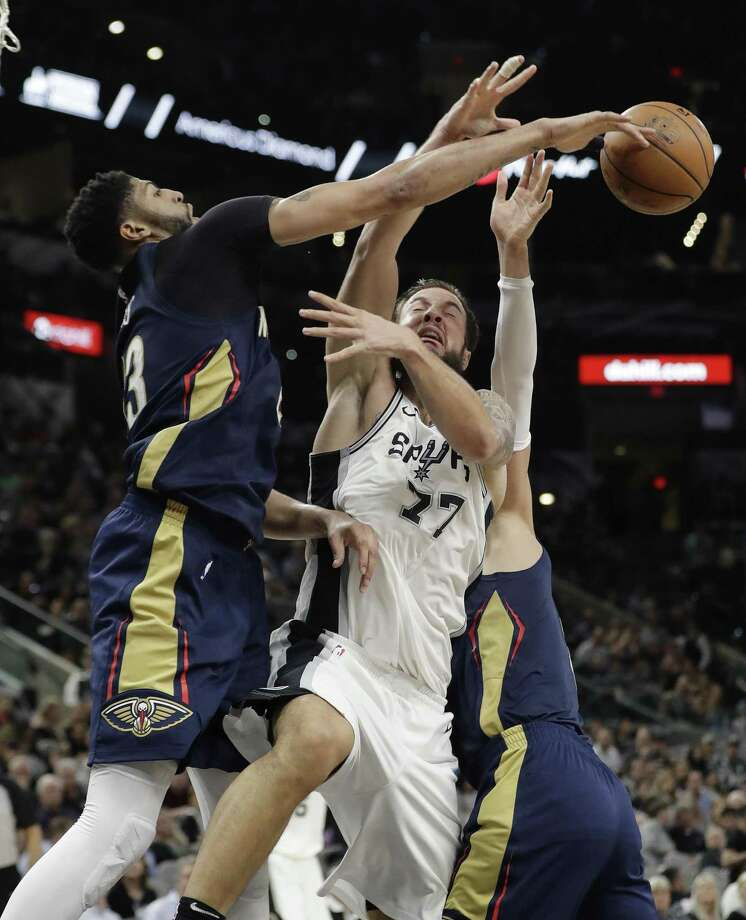 Anthony Davis also was dominant on defense, as the Spurs' Joffrey Lauvergne can attest. Photo: Eric Gay / Associated Press / Copyright 2018 The Associated Press. All rights reserved.
