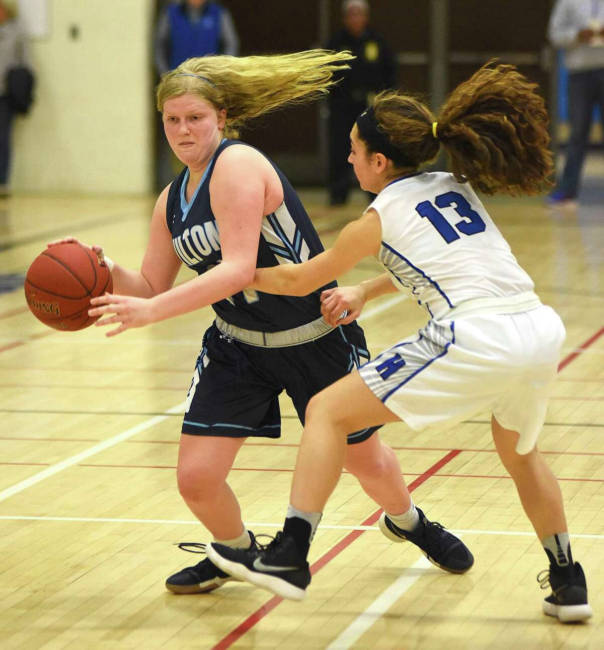 Claire Gulbin, left, looks for dribbling room past Hall's Jenna Zydanowicz during Thursday's CIAC Class LL second-round game in West Hartford. Hall won 52-47.