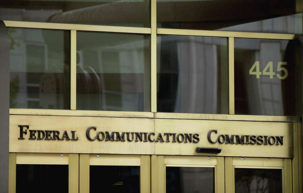 This June 19, 2015, file photo, shows the entrance to the Federal Communications Commission building in Washington.