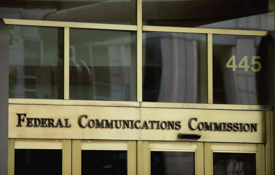 Entrance to the Federal Communications Commission building in Washington, D.C. The current Congressional Review Act resolution pending in the House of Representatives would enact divisive, stifling rules that go far beyond net neutrality and instead put the Federal Communications Commission in charge of prices, deployment, service options and more. Photo: Andrew Harnik, STF / Associated Press / Copyright 2017 The Associated Press. All rights reserved.