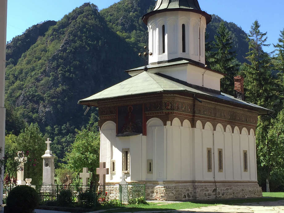 A chapel on the grounds of Turnu Monastery displays the whitewashed outer walls and decorative band below the eaves typical of Ottoman-inflected Orthodox Church architecture in the Olt Valley. Photo: Photo For The Washington Post By Christine Pendzich / For The Washington Post