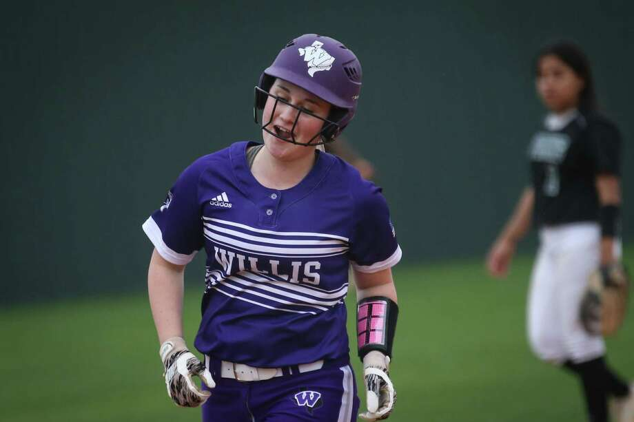 Willis' Madison Matranga (18) laughs while rounding the bases after hitting the game tying home run during the softball game against Spring on Saturday, Feb. 24, 2018, at Willis High School. (Michael Minasi / Houston Chronicle) Photo: Michael Minasi, Staff Photographer / © 2017 Houston Chronicle
