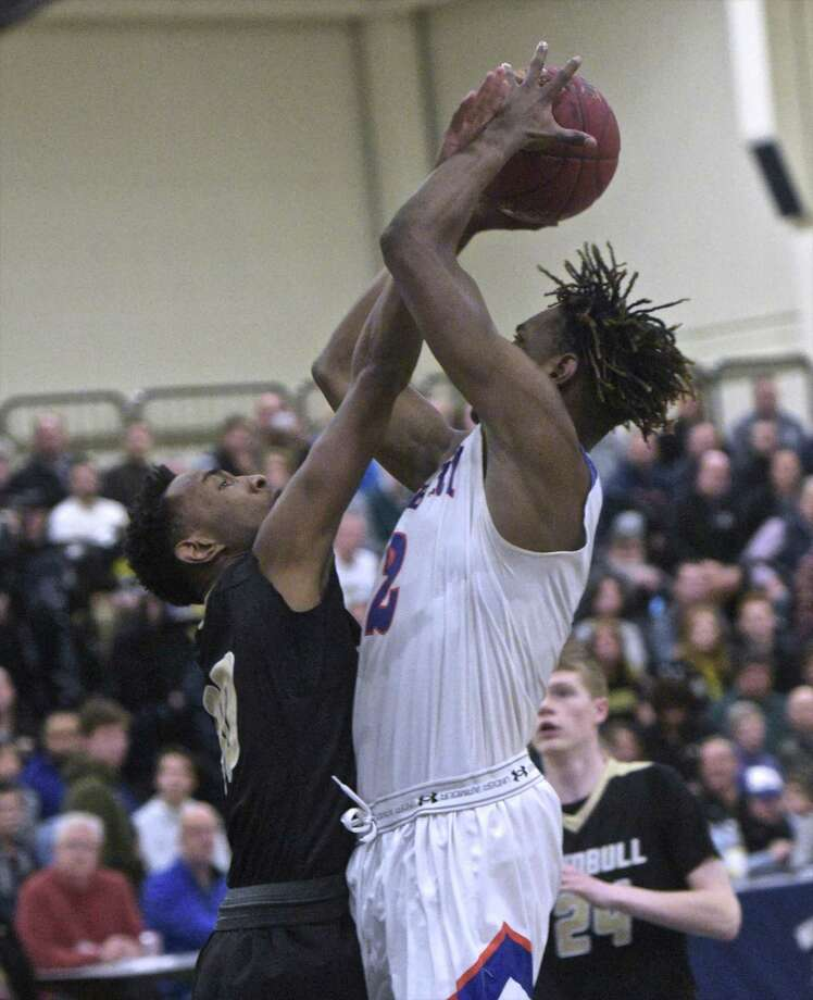 Danbury's Denali Burton (2) shoots over Trumbull's Timmond Williams (30) in the FCIAC boys basketball championship game between Trumbull and Danbury high schools, Thursday, March 1, 2018, at Wilton High School, Wilton, Conn Photo: H John Voorhees III / Hearst Connecticut Media / The News-Times