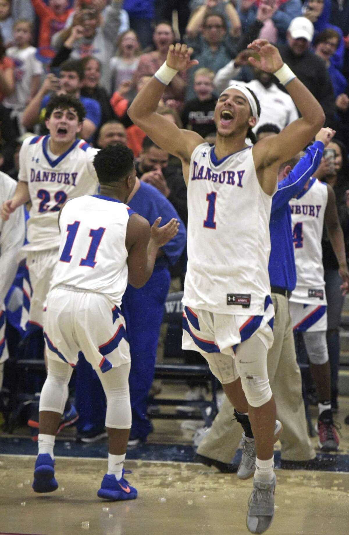 Danbury's Diante Vines (1) celebrates after the Hatters defeated Trumbull to win the FCIAC title on Thursday.