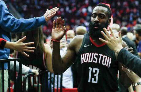Houston Rockets guard James Harden (13) high fives fans as he leaves the court after the Rockets 113-102 win over the Phoenix Suns at Toyota Center on Sunday, Jan. 28, 2018, in Houston. ( Brett Coomer / Houston Chronicle )