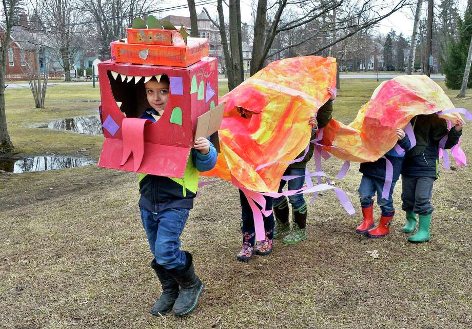 Timmy Fuller, left, leads preschoolers from the Round Lake School as they parade in a dragon costume to celebrate Chinese New Year Thursday March 1, 2018 in Round Lake, NY.  (John Carl D'Annibale/Times Union) Photo: John Carl D'Annibale / 20043105A