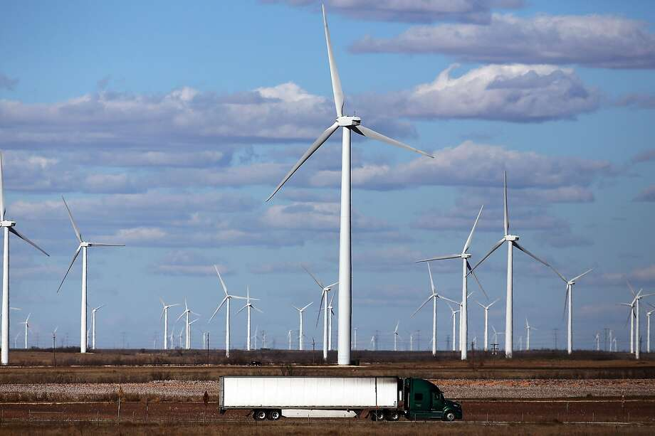 Wind turbines are viewed at a wind farm on January 21, 2016 in Colorado City, Texas. Wind power accounted for 8.3 percent of the electricity generated in Texas during 2013. Texas, which in just the last five years has tripled its oil production and delivered hundreds of billions of dollars into the economy, is looking at what could be a sustained downturn in oil prices. Oil, which has now fallen to under $30 a barrel, has forced many oil companies to let go of workers and to abandon future projects.  (Photo by Spencer Platt/Getty Images) Photo: Spencer Platt, Getty Images