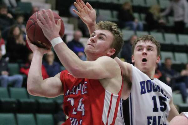 Hoosick Falls' Max Kipp attempts a block as Maple Hill's Nick Butler goes up for a shot during the Section II Class C boys' basketball semifinal at Cool Insuring Arena in Glens Falls, NY Thursday, March 1, 2018. (Ed Burke-Special to The Times Union)