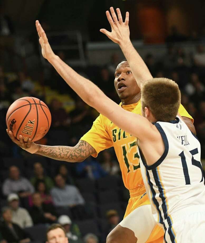 Siena's Khalil Richard drives to the basket guarded by Quinnipiac's Rich Kelly during a first-round MAAC basketball game at the Times Union Center on Thursday, March 1, 2018 in Albany N.Y. (Lori Van Buren/Times Union) Photo: Lori Van Buren / 20043036A