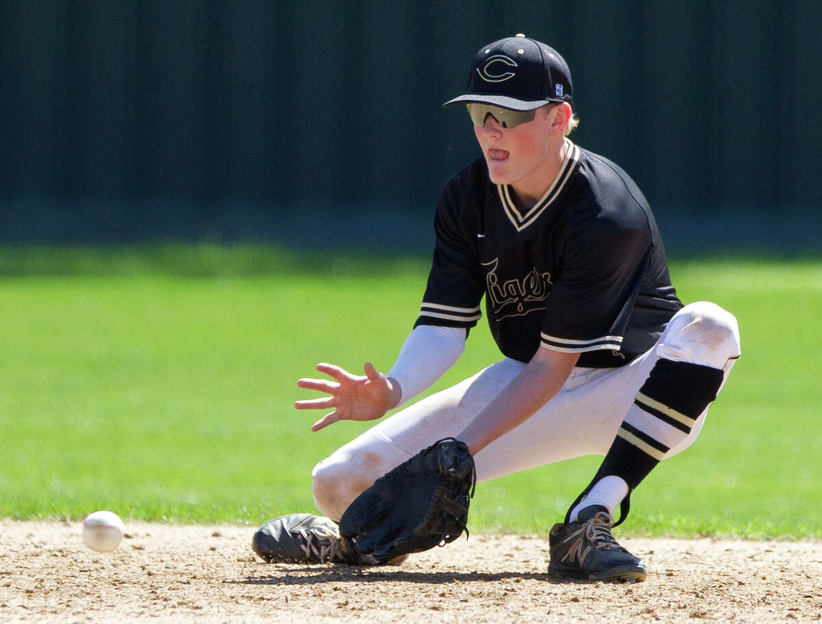Conroe second baseman Logan Ringo (1) fields a ground ball by Weston Wilkinson #7 of Stratford in the sixth inning of a high school baseball game during the Ferrell Classic at Conroe High School, Thursday, March 1, 2018, in Conroe.