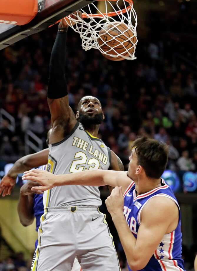 Cleveland Cavaliers' LeBron James (23) dunks against Philadelphia 76ers' Dario Saric, from Croatia, in the first half of an NBA basketball game, Thursday, March 1, 2018, in Cleveland. (AP Photo/Tony Dejak) Photo: Tony Dejak / AP 2018