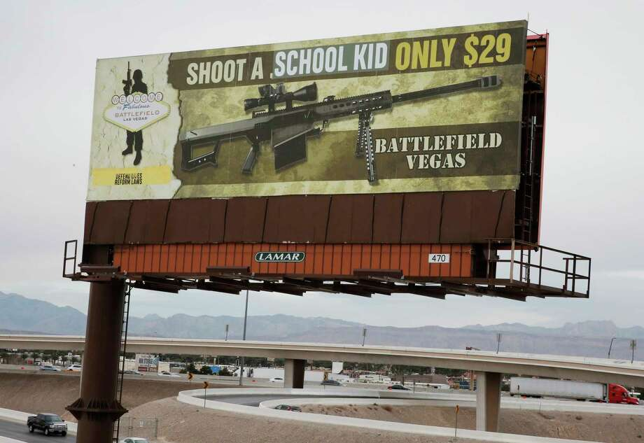 "This Thursday, March 1, 2018 shows a vandalized billboard near Interstate 15 in Las Vegas. The advertisement inviting tourists to fire an assault-style rifle, which originally said ""Shoot a .50 caliber only $29,"" was changed to say, ""Shoot A School Kid Only $29."" (Bizuayehu Tesfaye/Las Vegas Review-Journal via AP) Photo: Bizuayehu Tesfaye / Las Vegas Review-Journal"
