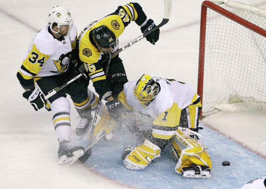Boston Bruins center David Krejci (46) scores against Pittsburgh Penguins goaltender Casey DeSmith (1) as Penguins right wing Tom Kuhnhackl (34) defends during the first period of an NHL hockey game Thursday, March 1, 2018, in Boston. (AP Photo/Elise Amendola) Photo: Elise Amendola / Copyright 2018 The Associated Press. All rights reserved.