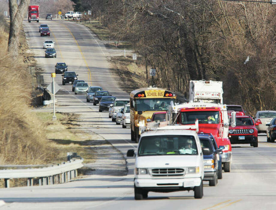 Vehicles make their way along Illinois Route 143 over the bridge at Indian Creek Thursday. The Illinois Department of Transportation will begin replacement of that bridge in early spring, with construction and road closures expected to last through mid-November. The road carries an estimated 10,000 vehicles per day. Photo: Scott Cousins   The Telegraph