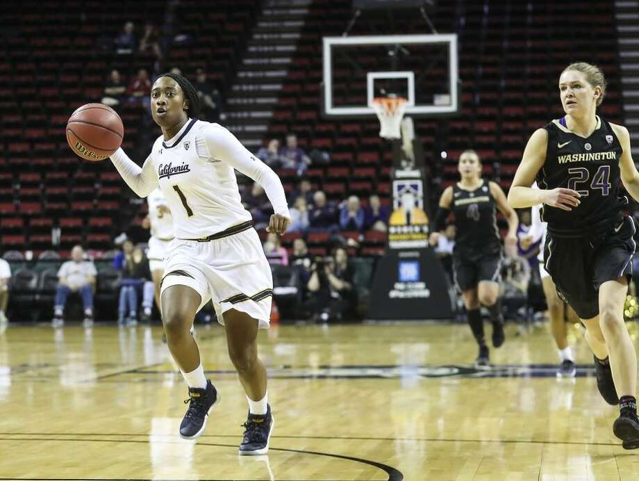 """Cal junior Asha Thomas takes the ball into the key. The 5' 4"""" guard sparked the Bears' offense with 22 points. Photo: Courtesy Eric Evans / Courtesy Eric Evans"""