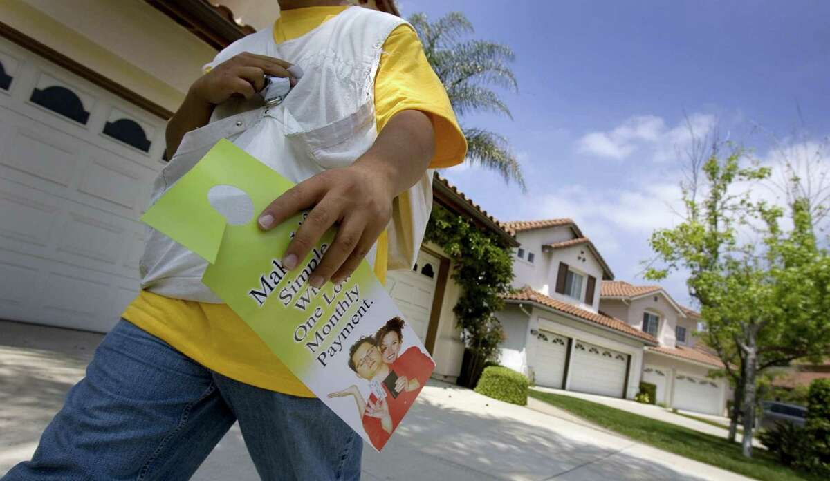 A California man goes door to door in 2007 distributing marketing materials for an electricity company. Closing out 2017, the Norwalk, Conn.-based electricity biller Crius Energy is turning to door-to-door sales with the goal of reaching more potential customers as telemarketing is thwarted by call blocking.