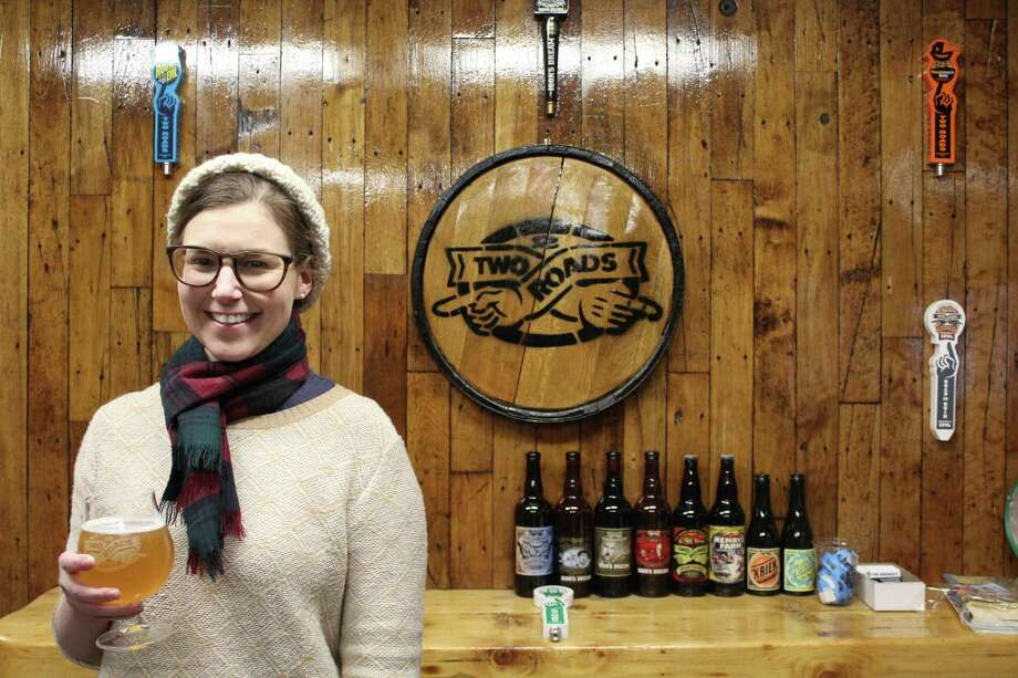 Emily Sauter, of Darien, is an Advanced Cicerone and works at Two Roads Brewery in Stratford. Photo: Humberto J. Rocha / Hearst Connecticut Media / Darien News