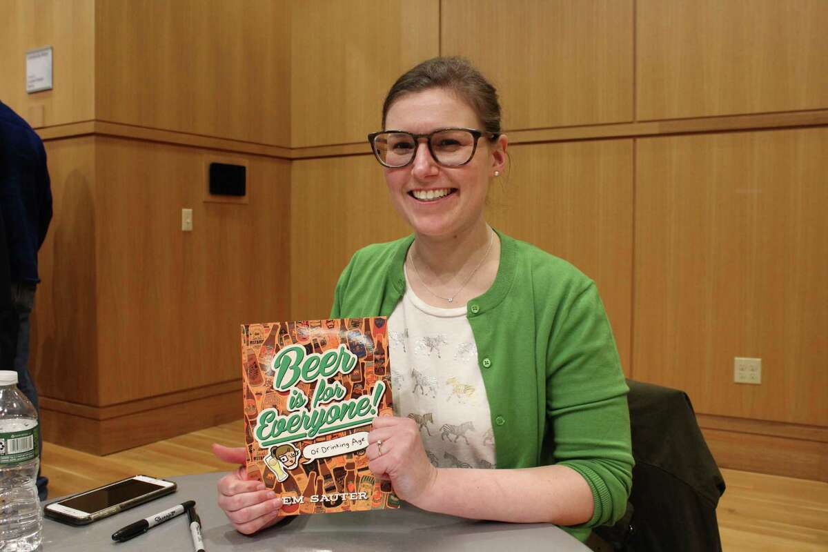 """Em Sauter presents her book """"Beer is for Everyone (of Drinking Age)"""" at the Darien Library on Feb. 21."""