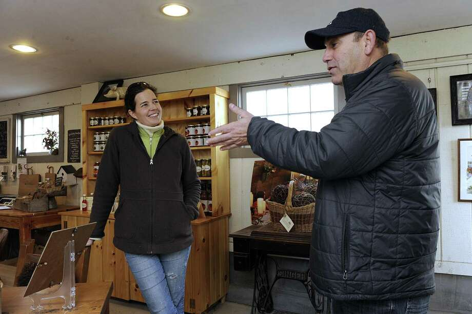 Dina Brewster, left, owner of The Hickories in Ridgefield, and Rob Kaye, owner of Nod Hill Brewery, have collaborated to make a seltzer using sap from maple, oak and hickory trees. Photo: Carol Kaliff / Hearst Connecticut Media / The News-Times