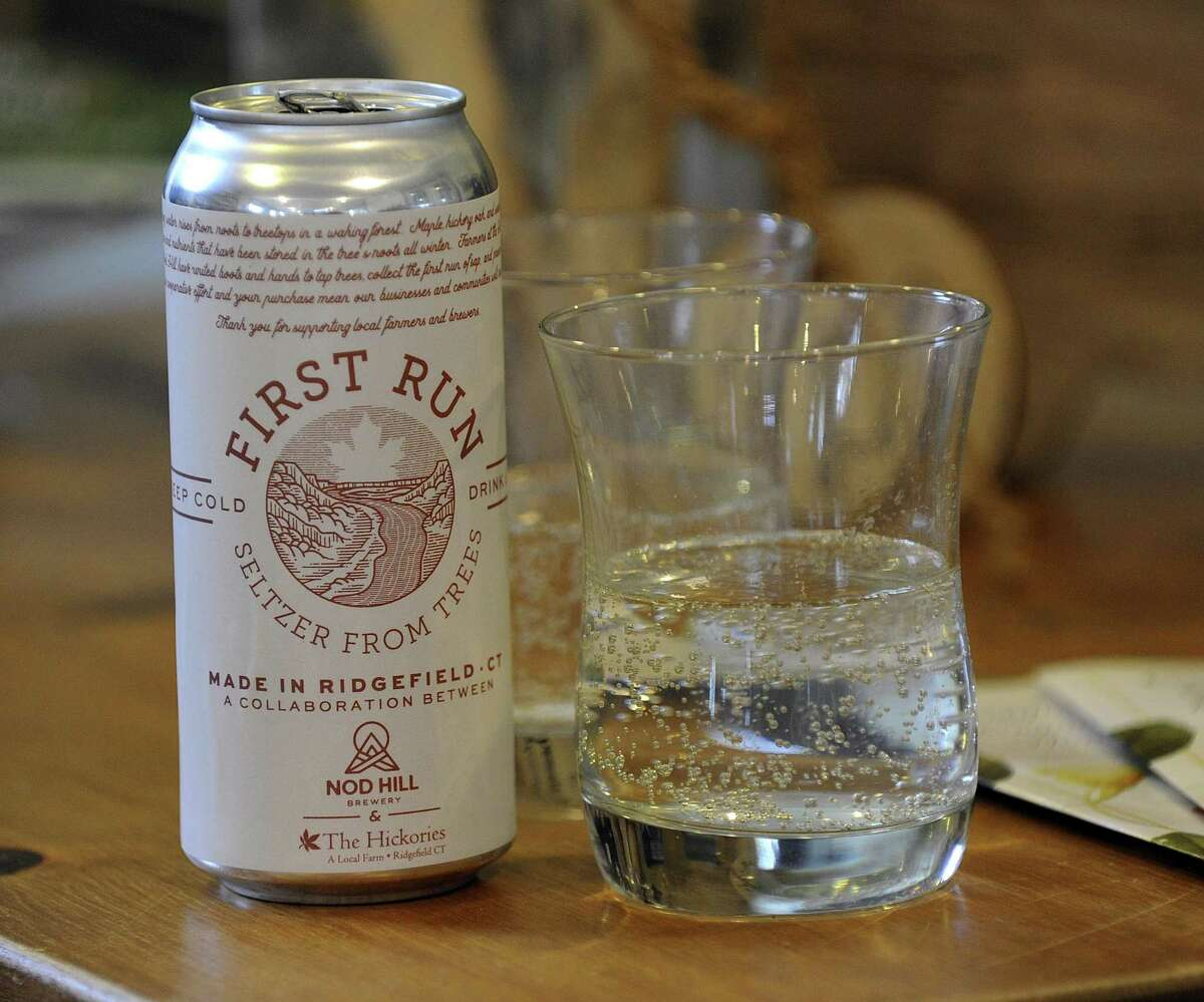 Dina Brewster, owner of The Hickories in Ridgefield, and Rob Kaye, owner of Nod Hill Brewery, have collaborated to make a seltzer using sap from maple, oak and hickory trees.