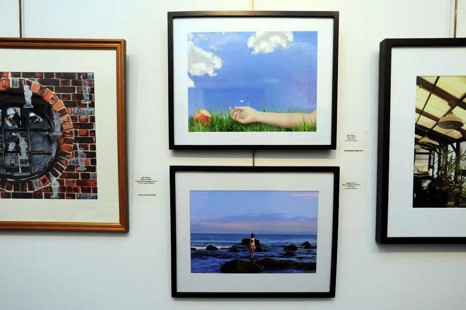 """St. Luke's School students Meg Adams, above center, and Bridget Dalton, below center, have colorful art hanging in the 45th annual Stamford Art Associations student art show inside the Stamford Art Association Townhouse on Franklin Street in downtown Stamford, Conn. on Thursday, Feb. 22, 2018. Adams """"Snow White"""" was named an honorable mention. Photo: Michael Cummo / Hearst Connecticut Media / Stamford Advocate"""