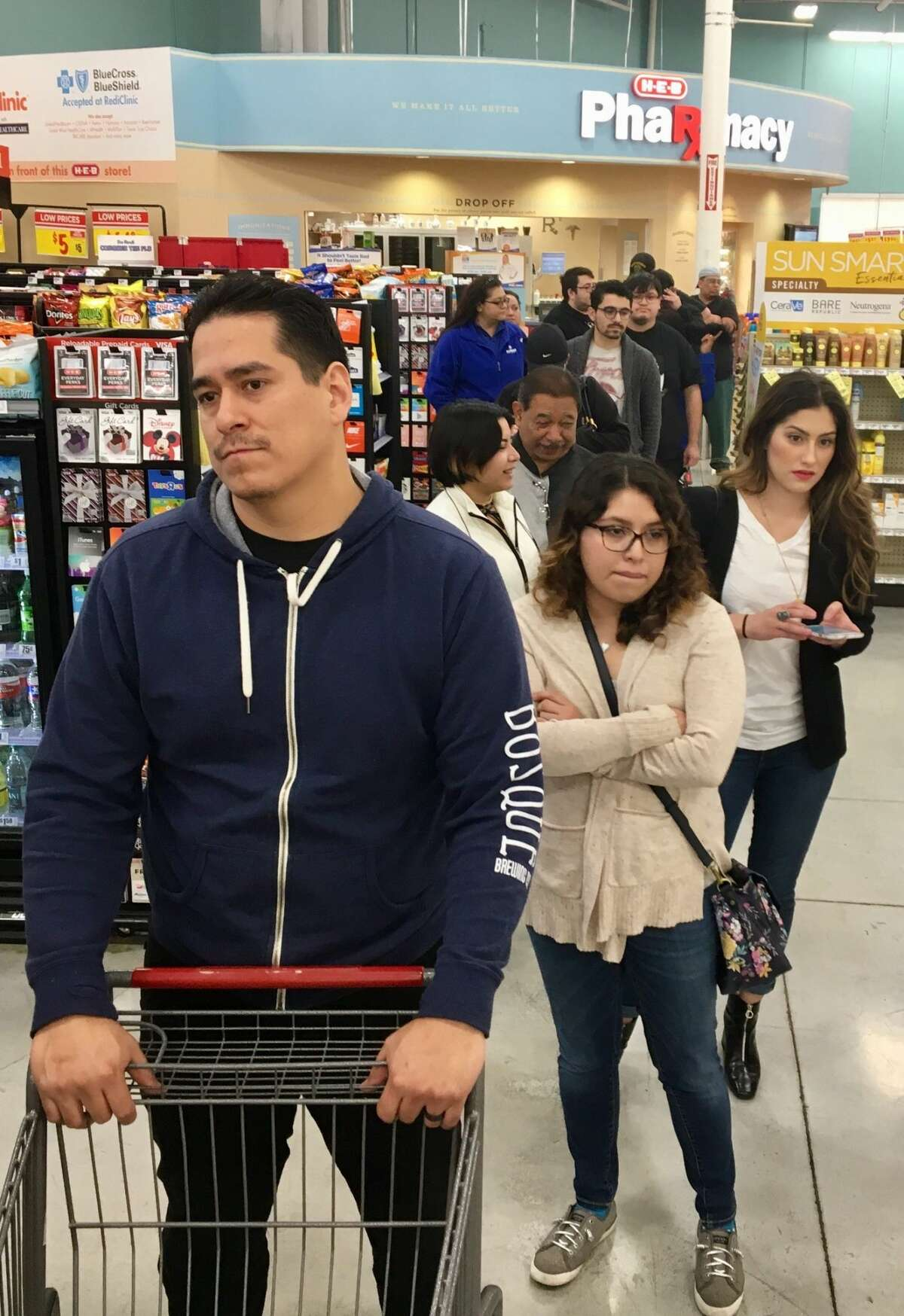 San Antonians wait in line at H-E-B at Alon Market for the hyped Selena bag on Friday, March 2, 2018. Bags reportedly sold out by 9:15 a.m. at the store, 15 minutes after they went on sale.