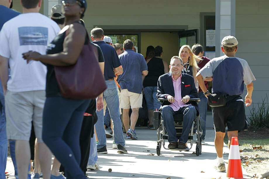 Toby Cole, center, exits the polling place at Nottingham Park during an election in 2016. The county has been sued over accessibility of its voting places by disabled voters. Photo: James Nielsen / James Nielsen / Houston Chronicle / © 2016  Houston Chronicle