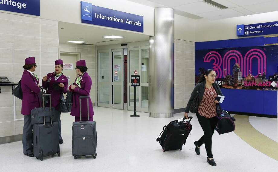 A Volaris flight crew waits outside the international arrivals at the San Antonio International Airport, Thursday, March 1, 2018. The crew was on a flight from Mexico City. Volaris is a low fare airline based in Mexico. A thriving local economy and a slate of new flights spurred passenger traffic to San Antonio International Airport to grow by double digits in February, city aviation officials said Monday. Photo: JERRY LARA /San Antonio Express-News / © 2018 San Antonio Express-News