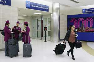 A Volaris flight crew waits outside the international arrivals at the San Antonio International Airport, Thursday, March 1, 2018. The crew was on a flight from Mexico City. Volaris is a low fare airline based in Mexico. A thriving local economy and a slate of new flights spurred passenger traffic to San Antonio International Airport to grow by double digits in February, city aviation officials said Monday.