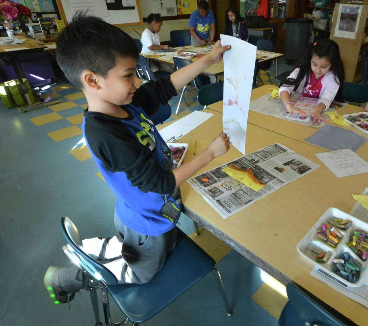 Jefferson Tacuro checks his progress on his traditional Asian landscape during Rhonda Siletto's third-grade art class at Tracey Elementary School on Wednesday, Feb.21 in Norwalk.