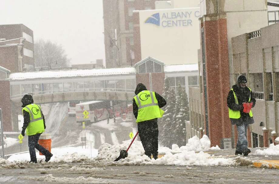 Workers are seen shoveling and salting the crosswalk on Eagle St. along Madison Ave. during a nor'easter on Friday, March 2, 2018 in Latham, N.Y. (Lori Van Buren/Times Union) Photo: Lori Van Buren, Albany Times Union