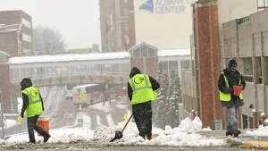 Workers are seen shoveling and salting the crosswalk on Eagle St. along Madison Ave. during a nor'easter on Friday, March 2, 2018 in Latham, N.Y. (Lori Van Buren/Times Union)