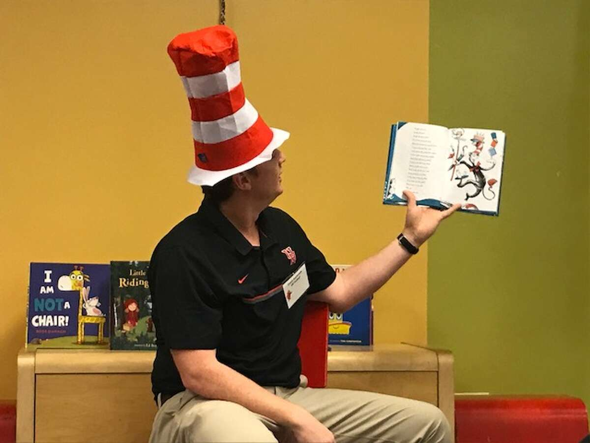UH coach Major Applewhite reads to students at the University of Houston Charter School as part of Friday's Read America Day.