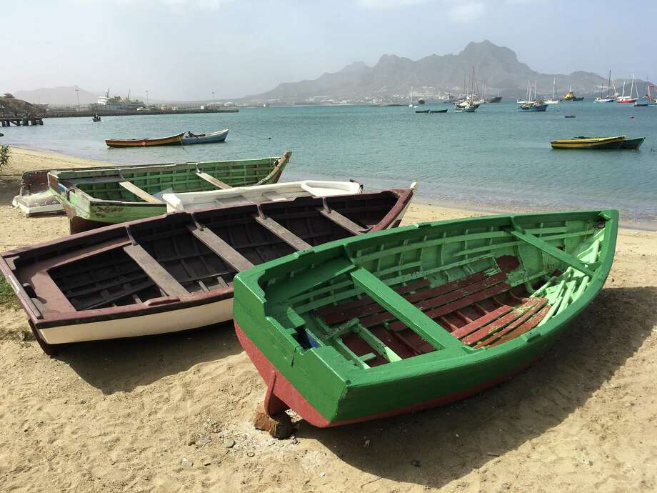 Traditional Cape Verdean boats, painted in bright colors, on the beach in Mindelo. Photo: Photo For The Washington Post By Mary Winston Nicklin / Mary Winston Nicklin