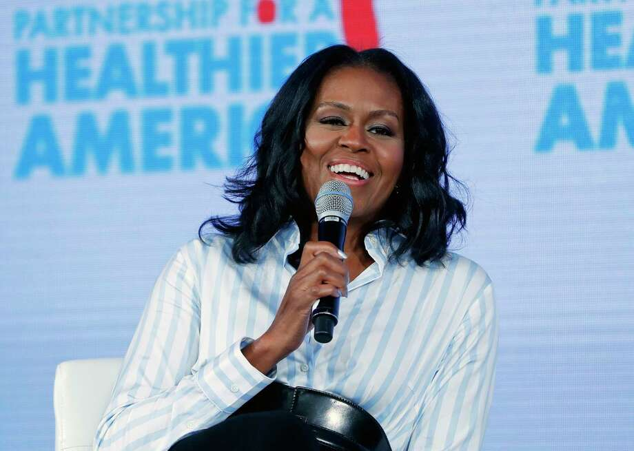 "FILE - In this May 12, 2017, file photo, former first lady Michelle Obama smiles while speaking at the Partnership for a Healthier American 2017 Healthier Future Summit in Washington.  The former first lady tweeted Sunday, Feb. 25, 2018 that her memoir, one of the most highly anticipated books in recent years, is coming out Nov. 13, 2018, and is called ""Becoming."" (AP Photo/Pablo Martinez Monsivais, File) Photo: Pablo Martinez Monsivais / Copyright 2017 The Associated Press. All rights reserved."