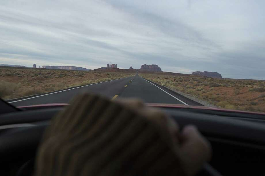 MONUMENT VALLEY, AZ - DECEMBER 31: TA car drives through Monument Valley on December 31, 2017 in Arizona's Navajo Reservation.. (Photo by Andrew Lichtenstein/ Corbis via Getty Images) Photo: Andrew Lichtenstein / 2018 Andrew Lichtenstein