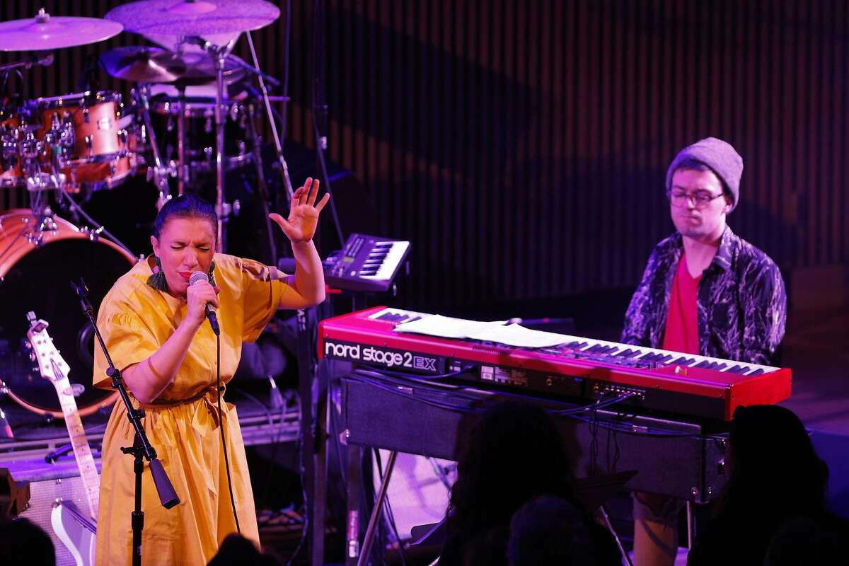 Snarky Puppy performs at the San Francisco Jazz Center with Magda Giannikou of Banda Magda, left, in San Francisco, Calif., on Thursday, March 1, 2018. The Brooklyn-based funk collective won the best contemporary instrumental album at last year's Grammys and features a revolving cast of up to a dozen musicians playing guitars, percussion, horns, keyboards and sometimes strings.