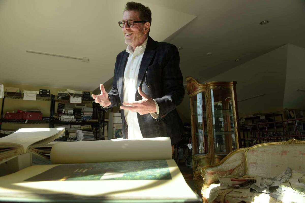 Interior designer Bill Allen talks about wallpaper as he is surrounded by sample books of swatches of wallpaper during an interview at Bolt on Monday, Feb. 26, 2018, in Latham, N.Y. (Paul Buckowski/Times Union)