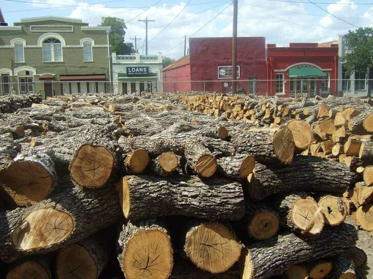 "Stacks of post oak wood are left to air dry outside Smitty's Market in Lockhart. Ideally, the ""aged"" wood should have a moisture content of about 20 percent."