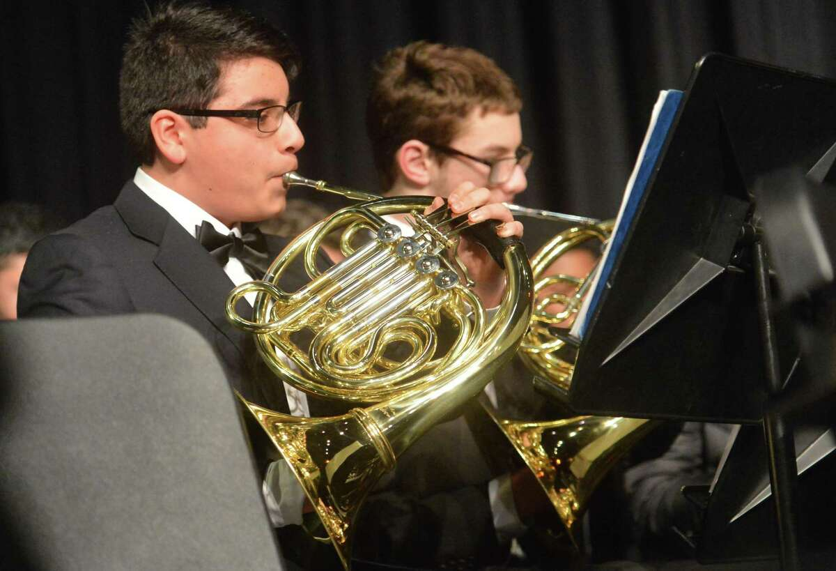 The Brien McMahon High School Honors Wind Symphony performs during the Winter Band Concert featuring the Westport Community Band to benefit the Open Door Shelter on Thursday at Brien McMahon High School in Norwalk.