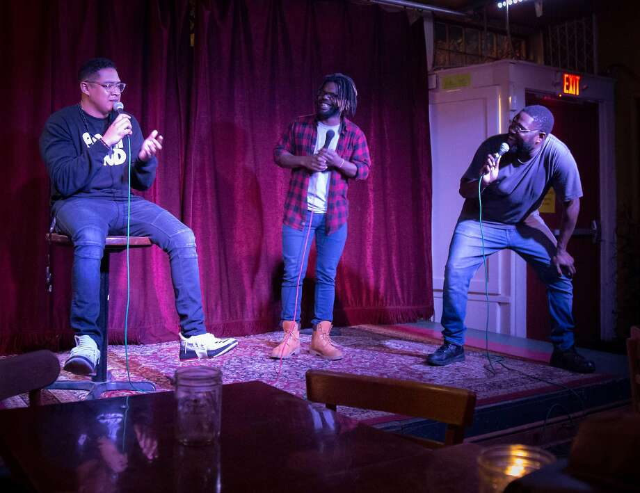 Co-hosts Shain Brenden (left) and Marcus Coleman welcome the crowd with comic Thomas Lundy (middle). Photo: Kim I. Mott, Special To The Chronicle
