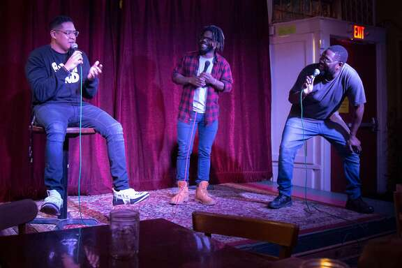Co-hosts Shain Brenden (left) and Marcus Coleman welcome the crowd with comic Thomas Lundy (middle).