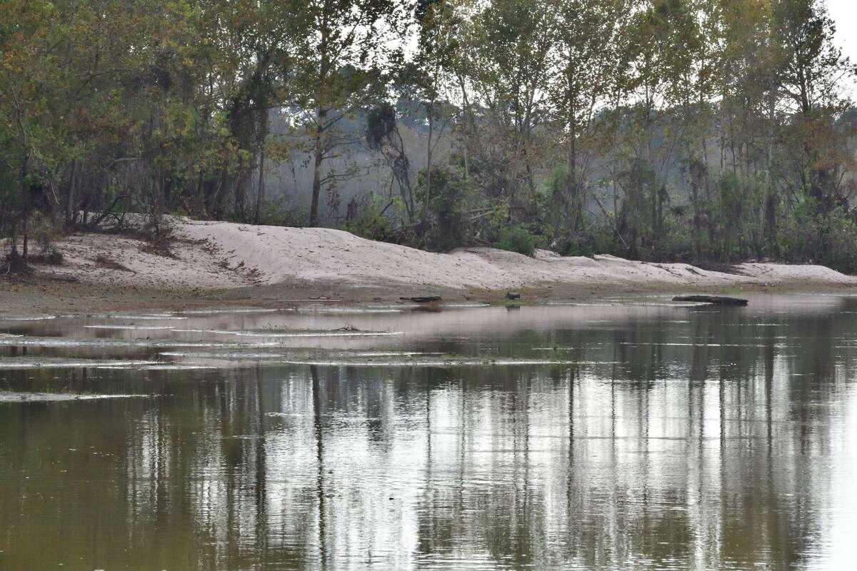 Mounds of sand line the banks of the San Jacinto River near Kingwood after Hurricane Harvey.