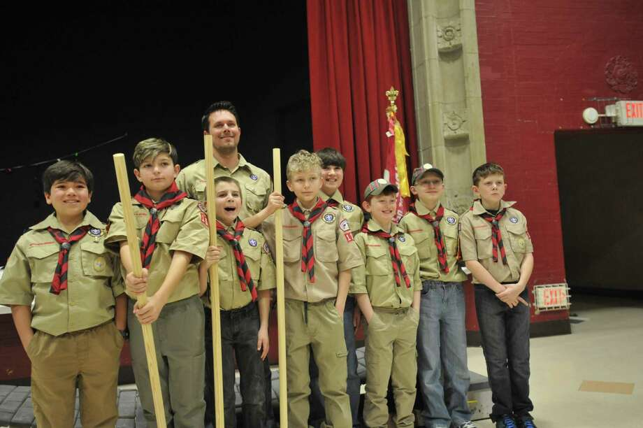 Marco Napoleone, Charles Ley, Jack Sullivan, Nicholas Waters, Kyle Meholik, Parker Godfrey, Stephen Mastriano, and Zachary Collins made the jump from Cub Scout to Boy Scout Thursday evening in Winsted. Photo: Ben Lambert / Hearst Connecticut Media