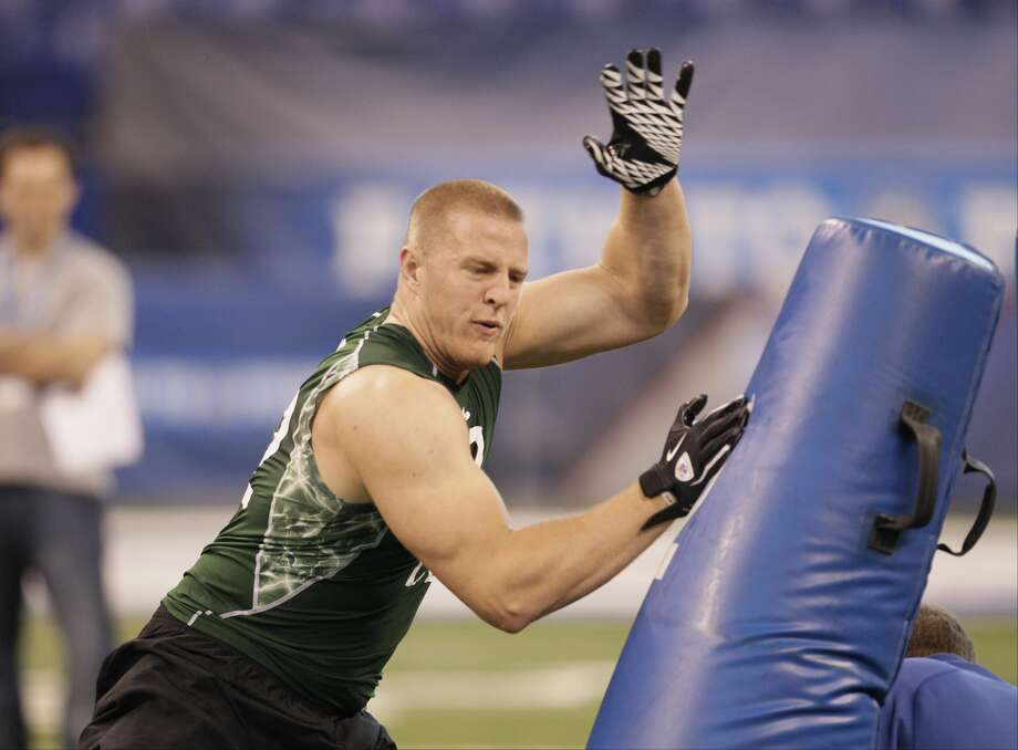 Wisconsin defensive end J.J. Watt runs a drill during the NFL scouting combine in Indianapolis on Monday, Feb. 28, 2011. (AP Photo/Darron Cummings)