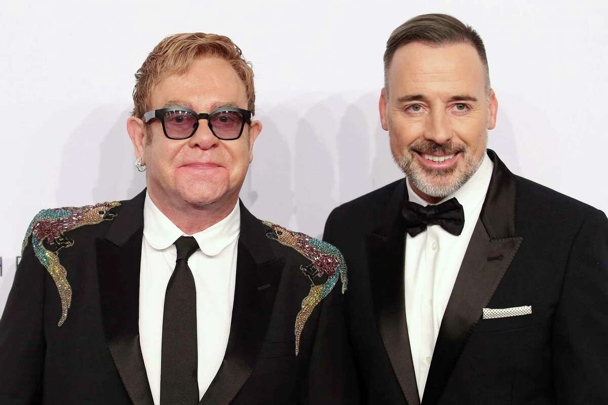 Elton John, left, and David Furnish attend the Elton John AIDS Foundation's 15th Annual An Enduring Vision Benefit at Cipriani Wall Street on Wednesday, Nov. 2, 2016, in New York.
